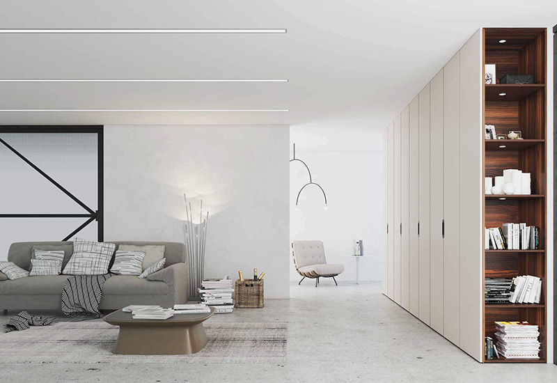 Spacious living room with white colored wardrobe