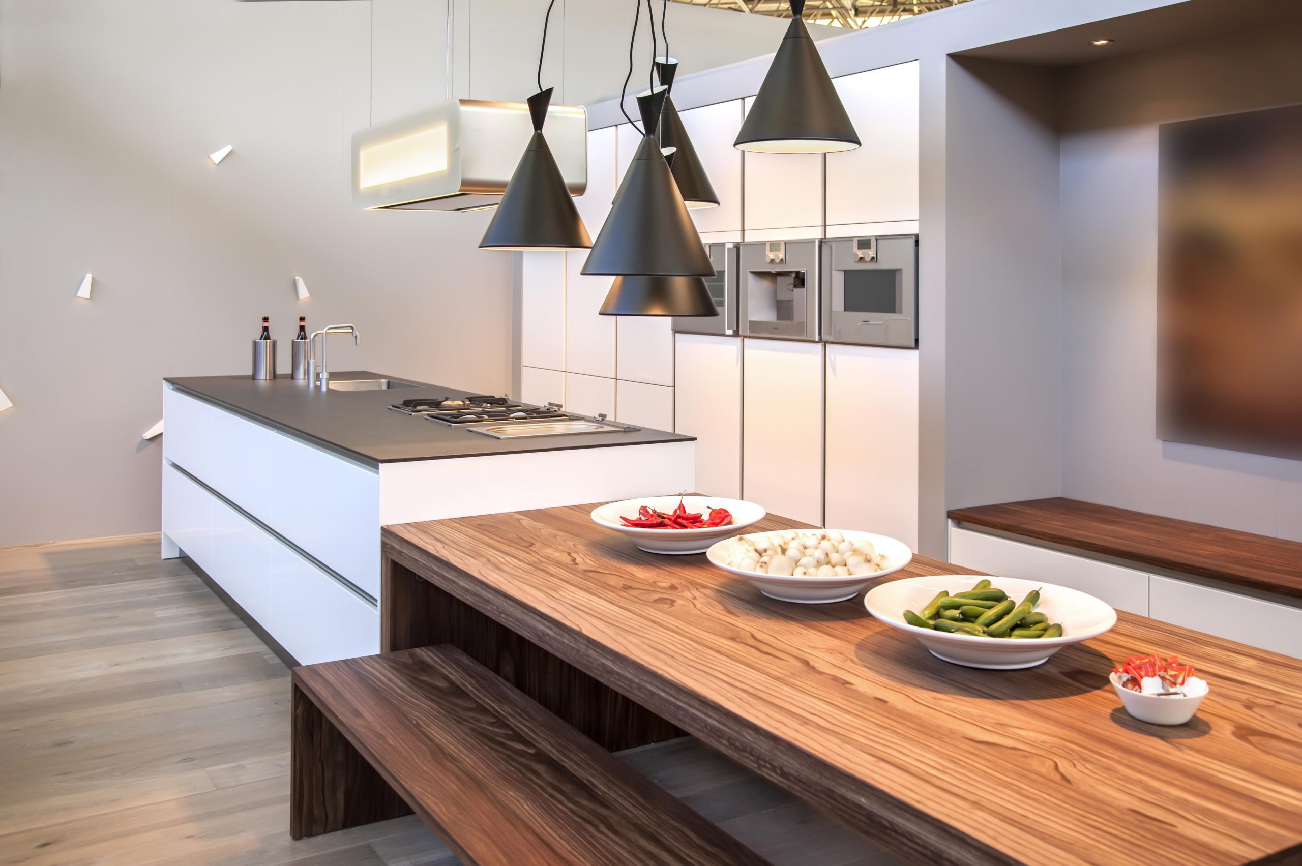 Aurora German kitchen with hanging lights and wooden dining table