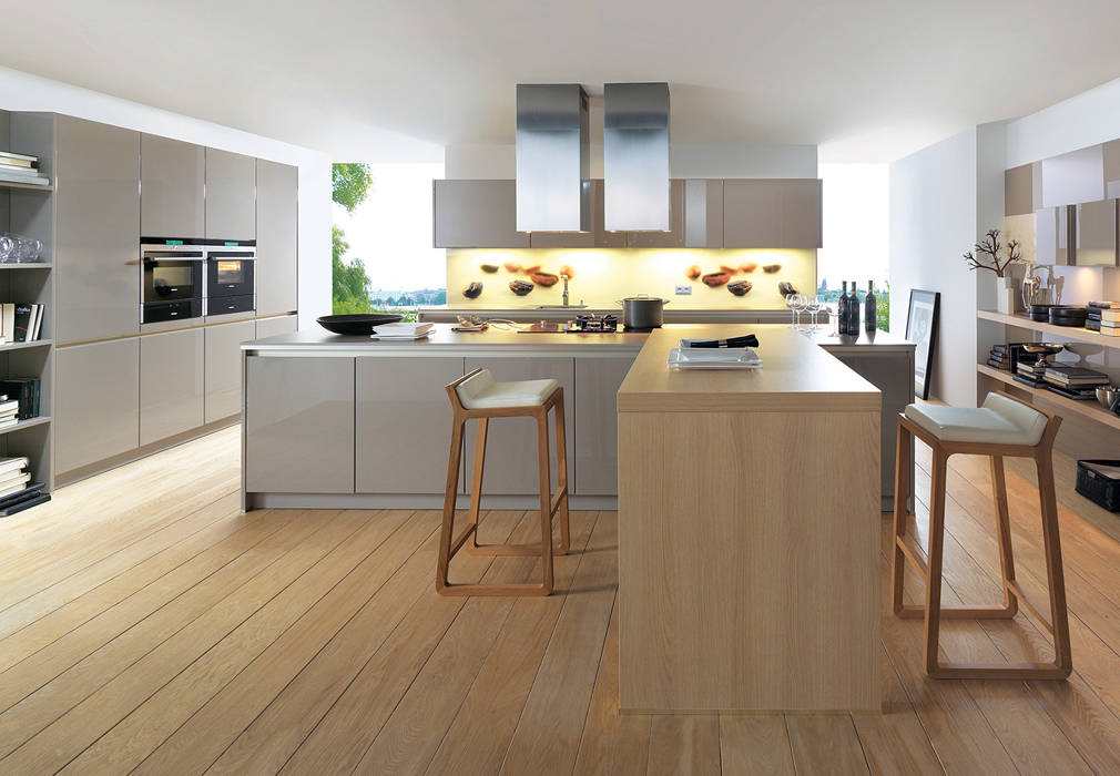 Spacious German kitchen design integrated with breakfast table