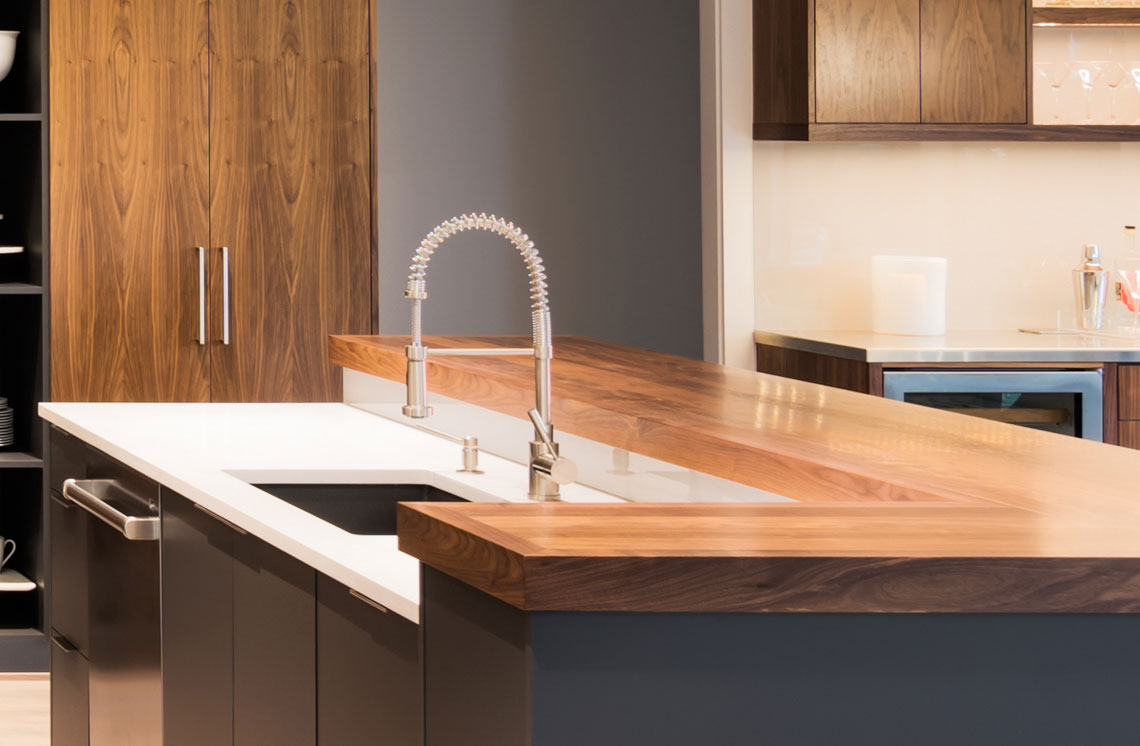 Wooden backsplash and white finish kitchen with worktop