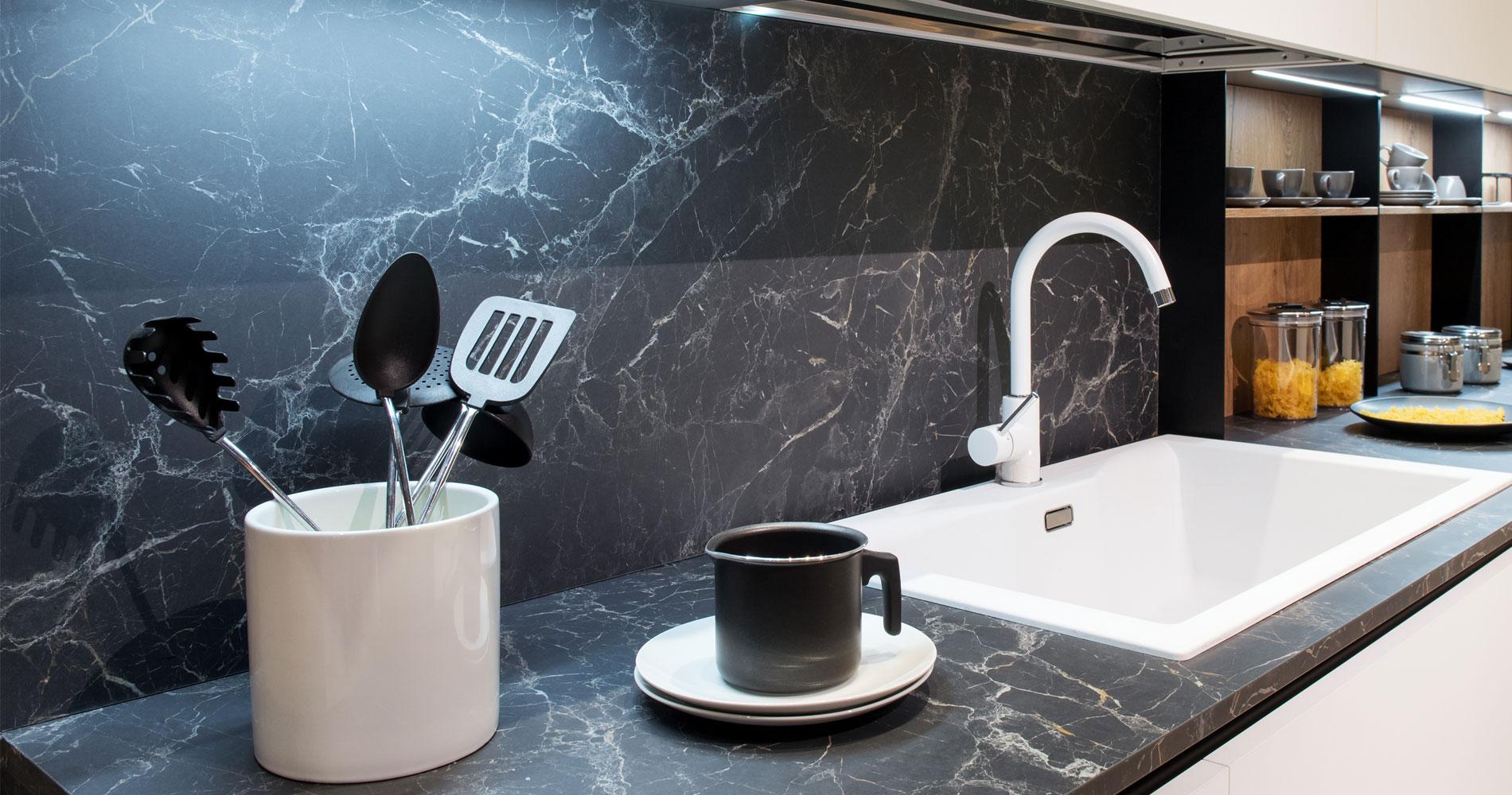 Beautiful custom stone and glass splashbacks with white sink