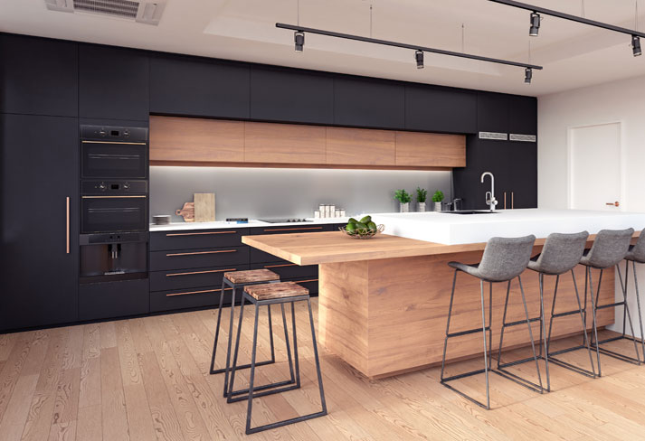 Scratch resistant quartz worktop along with extended wooden breakfast table