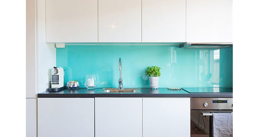 Vibrant aqua Colored glass splashback